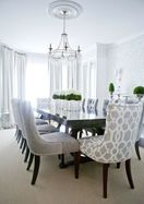 Anchor chairs upholstered in a complementary fabric add pizzazz to this formal dining roomPicture