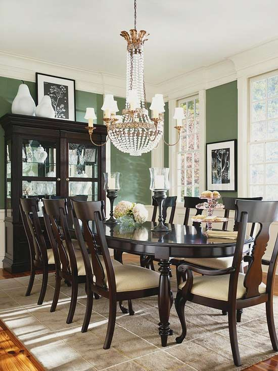 Wing chairs and contemporary lamps add a more modern feel to this formal dining room.